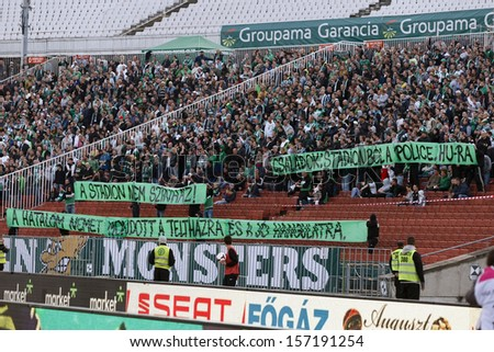 BUDAPEST - OCTOBER 6: Fans of FTC protest against legal prosecution of some peaceful supporters FTC vs. Honved OTP Bank League match at Puskas Stadium on October 6, 2013 in Budapest, Hungary.  - stock photo