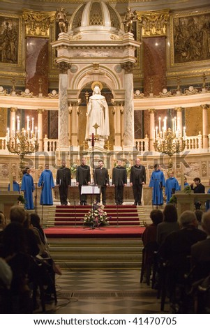 BUDAPEST - OCTOBER 10: Members of the Choir of Notre Dame de Paris perform at St Stephen Basilica (conductor: Lionel Sow) on October 10, 2009 in Budapest, Hungary.