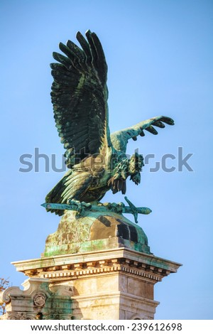 BUDAPEST - OCTOBER 21: Statue of Turulbird at the Royal castle on October 21, 2014 in Budapest, Hungary. The Turul is the most important bird in the origin myth of the Magyars (Hungarian people). - stock photo