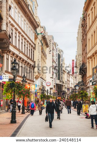 BUDAPEST - OCTOBER 22: Vaci street with tourists on October 22, 2014 in Budapest, Hungary. It's one of the main pedestrian thoroughfares and perhaps the most famous street of central Budapest - stock photo