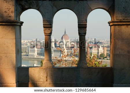 Budapest panorama - hungarian capital viewed trough arches - stock photo