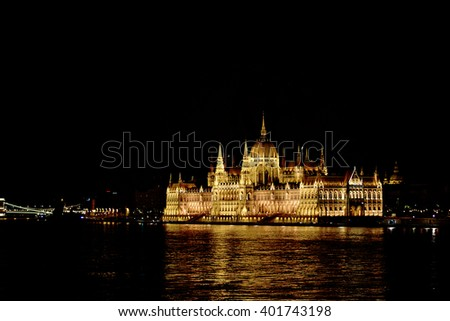 Budapest Parliament in Hungary at night on the Danube river - stock photo