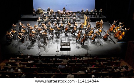 BUDAPEST - SEPT 14: Magyar Radio Symphonic Orchestra perform in concert at MUPA on September 14, 2012 in Budapest, Hungary. Conductor: Andras Ligeti - stock photo