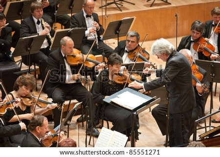 """BUDAPEST - SEPT 18: Magyar Radio Symphonic Orchestra perform on concert at """"Palace of Art"""" Budapest Sept 18, 2011 in Budapest, Hungary. Conductor: Gergely Vajda - stock photo"""