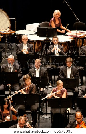 "BUDAPEST - SEPT 29: Savaria Symphonic Orchestra perform on concert  at ""Palace of Art"" Budapest Sept 29, 2011 in Budapest, Hungary. Conductor:  Tamas Vasary - stock photo"