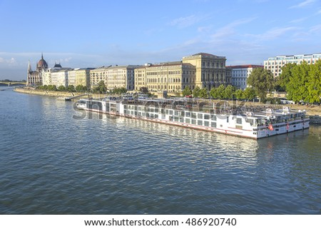 BUDAPEST, SEPTEMBER 17: Pleasure and cruise ships on the Danube River on September 17, 2016 in Budapest, Hungary. Tourist trips in Budapest on water transport are in great demand by travelers.