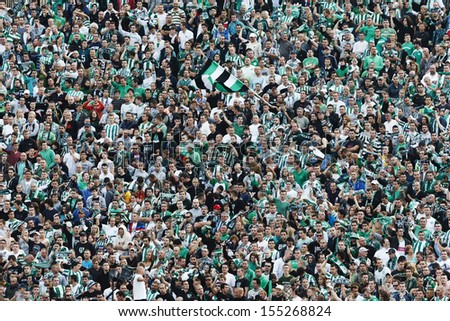 BUDAPEST - SEPTEMBER 22: Supporters of FTC during Ferencvaros vs. Ujpest OTP Bank League football match at Puskas Stadium on September 22, 2013 in Budapest, Hungary.  - stock photo