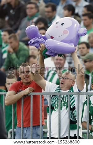 BUDAPEST - SEPTEMBER 22: Supporters of FTC provoke fans of UTE with a monkey during Ferencvaros vs Ujpest OTP Bank League football match at Puskas Stadium on September 22, 2013 in Budapest, Hungary - stock photo
