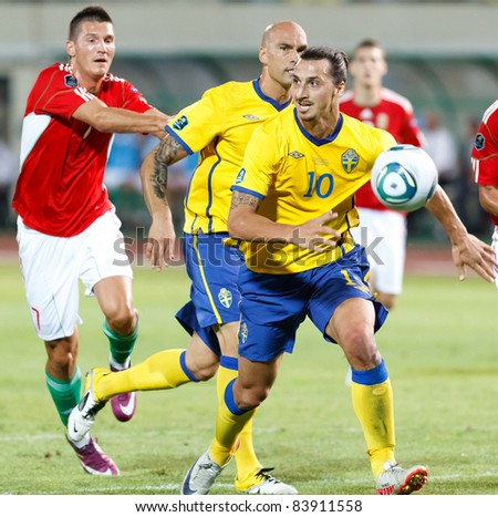 BUDAPEST - SEPTEMBER 2: Swedish Ibrahimovic (10) and Majstorovic (M), Pinter (L) during Hungary vs. Sweden UEFA Euro 2012 qualifying game at Puskas Stadium on September 2, 2011 in Budapest, Hungary