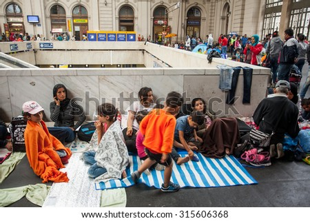 BUDAPEST - SEPTEMBER 4 :Transit zone at the Keleti Railway Station for war refugees on 4 September 2015 in Budapest, Hungary. Refugees are arriving constantly to Hungary on the way to Germany. - stock photo