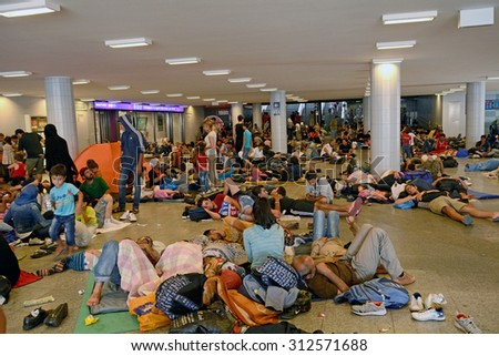BUDAPEST - SEPTEMBER 1 : War refugees at the Keleti Railway Station on 1 September 2015 in Budapest, Hungary. Refugees are arriving constantly to Hungary on the way to Germany. - stock photo