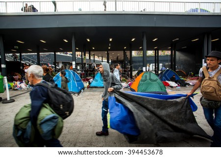 BUDAPEST - SEPTEMBER 4 : War refugees camp at the Keleti Railway Station on 4 September 2015 in Budapest, Hungary. Refugees are arriving constantly to Hungary on the way to Germany. - stock photo