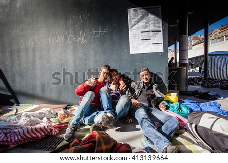BUDAPEST - SEPTEMBER 7: war refugees waiting for train at Keleti Railway Station on 7 September 2015 in Budapest, Hungary. Refugees are arriving constantly to Hungary on the way to Germany. - stock photo