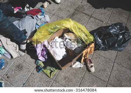 BUDAPEST - SEPTEMBER 7 : War syrian refugees at the Keleti Palyaudvar Railway Station on 1 September 2015 in Budapest, Hungary. Box containing personal effects of a refugee, left on the floor.