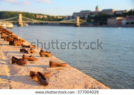 Budapest shoes - Holocaust memorial monument in Hungary. Sunset light. - stock photo