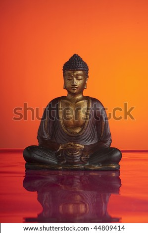 buddah on red - stock photo