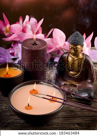 buddah witn candle and incense spa concept - stock photo
