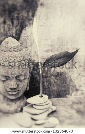 Buddha and flower bud. Black and white fine art photography. - stock photo