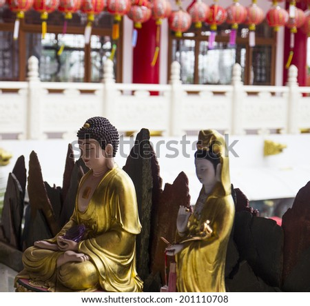 buddha and goddess of mercy statue in chinese temple - stock photo