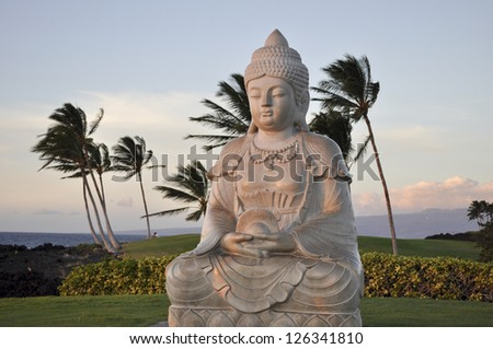 Buddha and palms - stock photo