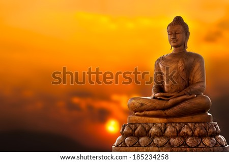 Buddha and sunset - stock photo