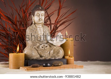 Buddha, candles and relax time - stock photo