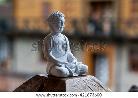 Buddha ceramic statue.  Yoga, buddhism, meditation background with empty space for text. - stock photo