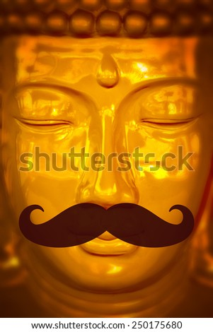 Buddha face with large false mustache like a hipster - stock photo