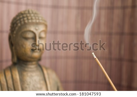 buddha figure with incense stick 2