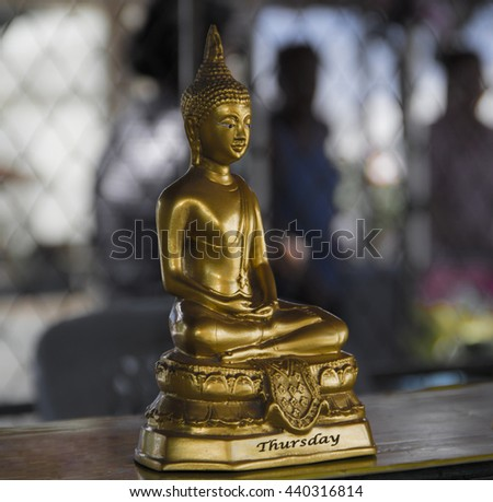 Buddha for people born Thursday. - stock photo
