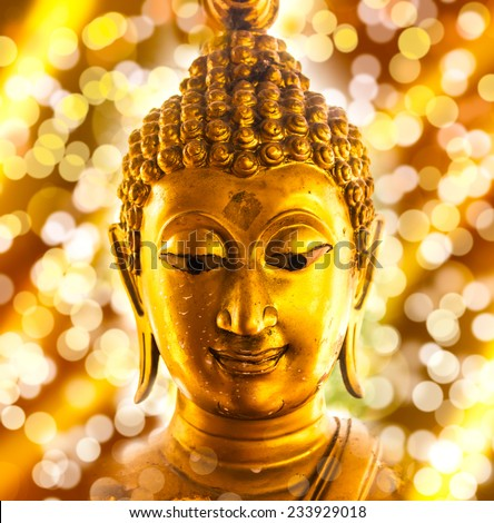 Buddha gold statue on bokeh background. - stock photo