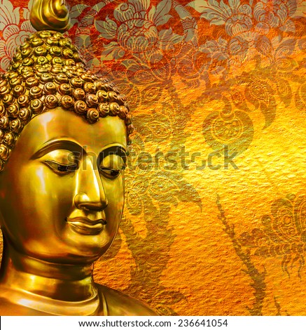 Buddha gold statue on golden background patterns Thailand. - stock photo