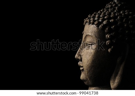 Buddha head on black with room for text - stock photo