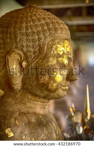 Buddha image at Wat Phra That Luang, landmark of Lao PDR in Vientiane - stock photo