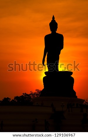 Buddha image in sunset.
