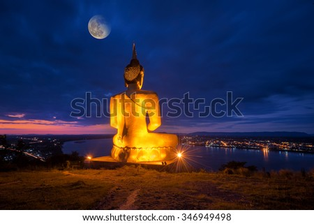 Buddha in blaze over the city at night - stock photo