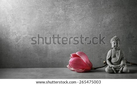 Buddha in meditation with magnolia flower