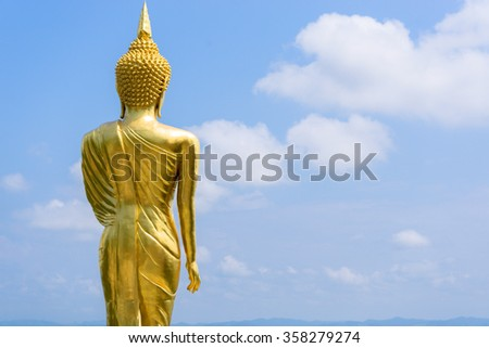 Buddha in the sky behind the scenes. - stock photo