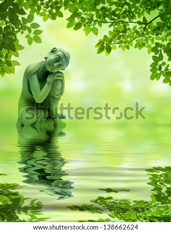Buddha in the woods reflecting in water - stock photo