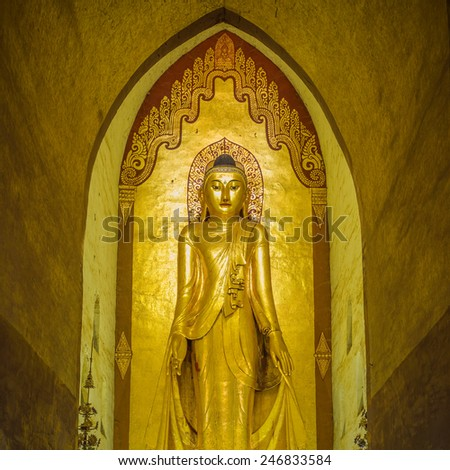 Buddha inside Ananda temple, Bagan, Myanmar. - stock photo