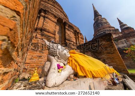 Buddha lying on the ancient bricks. - stock photo
