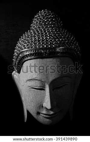 Buddha mask for home decoration in black and white - stock photo