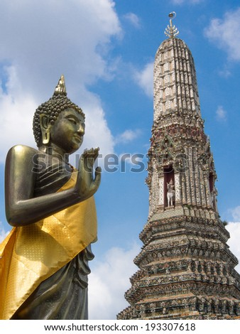 buddha on the attitude of persuading his relatives not to quarrel int The Temple of Dawn Wat Arun Bangkok, Thailand - stock photo