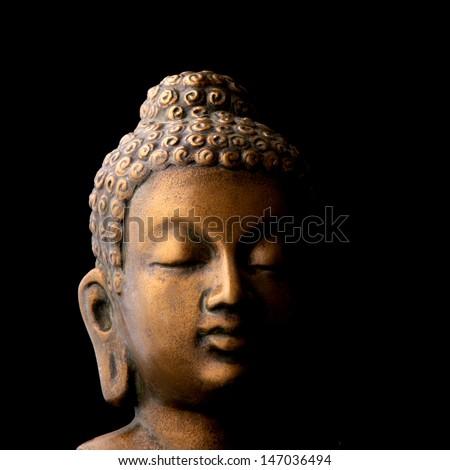 Buddha portrait isolated on black - stock photo