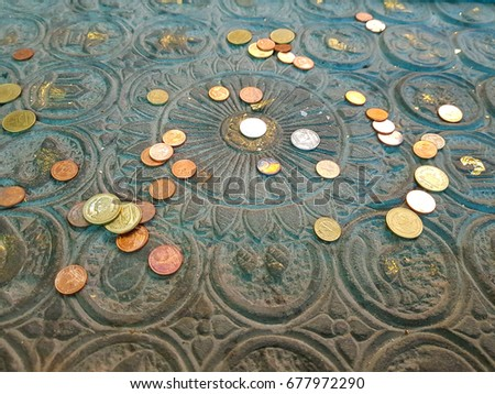 Buddha's footprint and coins