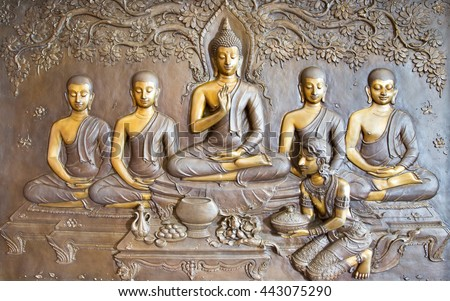 Buddha sculpture image.  Thai style metal carving and Asalha Puja Day - stock photo