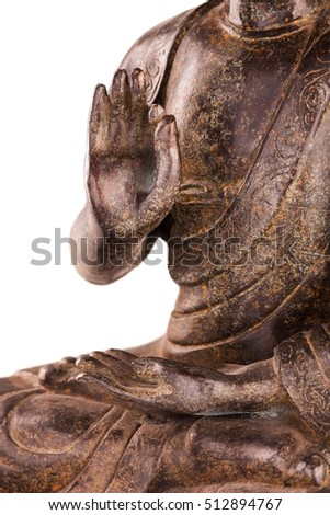 Buddha Shakyamuni's figure in a manual pose - vitarka mudra. The old statue made of metal isolated on a white background.