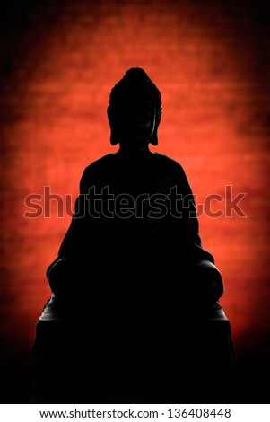 Buddha silhouette on red - stock photo