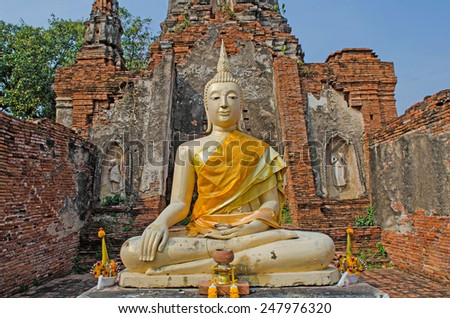 Buddha sitting in the old sanctuary in Thailand - stock photo