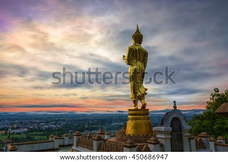 Buddha standing on a mountain at morning Wat Phra That Khao Noi, Nan Province, Thailand